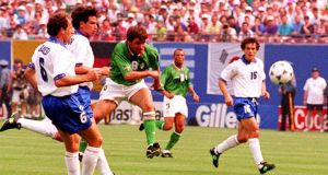 Ray Houghton scores against Italy during the  unforgettable World Cup victory at Giants Stadium in 1990. Photograph: Claudio Onorati/AFP/Getty