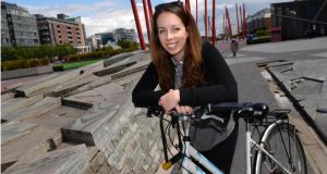 Meadhbh McHugh, with her not-so-beloved bicycle in Grand Canal Square, Dublin. Photograph: Dara Mac Dónaill