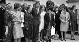 John F Kennedy poses with relatives   in Dunganstown, Co Wexford, on his visit to Ireland in 1963.