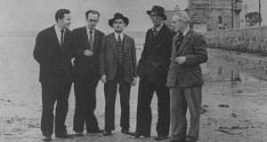 John Ryan, Anthony Cronin, Brian O'Nolan, Patrick Kavanagh and Tom Joyce on Sandymount Strand on Bloomsday 1954.