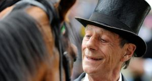 Horse racing trainer Sir Henry Cecil with Frankel at Ascot in June 2012. Photograph: Alan Crowhurst/Getty