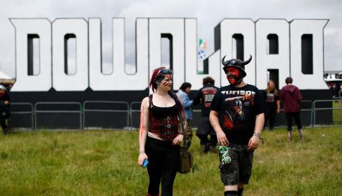Fans walk to the main stage during the Download rock music festival in Castle Donington, central England. Acts appearing at the metalfest include Slipknot, Korn, Iron Maiden and Rammstein. Photograph: Darren Staples/Reuters