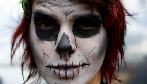 A painted music fan arrives at the  Download music festival. Photograph: Darren Staples/Reuters