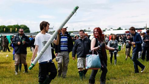 A man carries beer cups at the Download music festival. Photograph: Darren Staples/Reuters