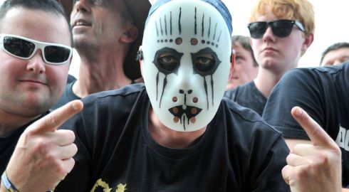 Is that Ricky Gervais on the left of this masked dude enjoying  3 Doors Down  at Download. Photograph: Lewis Stickley/PA Wire