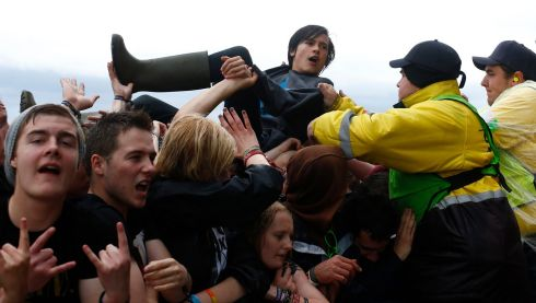 A fan is pulled from the moshpit. Photograph: Darren Staples/Reuters