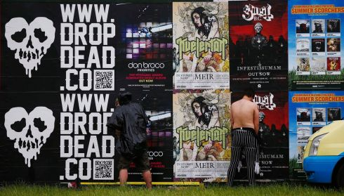 Stay classy, fellas.  Answering the call of the wild at  Download music festival. Photograph: Darren Staples/Reuters