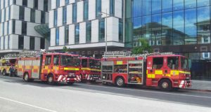 Numerous fire fighters battled a blaze on Pearse Street this afternoon as Garda officers diverted traffic away from the area onto Sandwith Street Lower.  Photograph: Peter Smyth