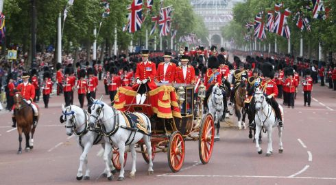 Pomp and slendour: The queen's carriage makes its way back towards Buckingham Palace. Photograph: Chris Jackson/Getty Images