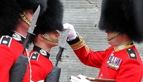The knives are out: First Battalion Scots Guards at Stirling Castle, Scotland, mark the queen's birthday. Photograph: Andrew Milligan /PA Wire