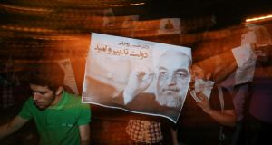 Supporters in Tehran with  a campaign poster for successful Iranian presidential candidate Hassan Rohani. Photograph: Mehdi Ghassemi/ISNA/Reuters