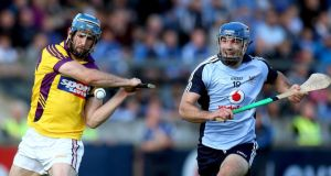 Dubln's Stephen Hiney and Garrett Sinnott of Wexford at Parnell Park.  Photograph: Ryan Byrne/Inpho