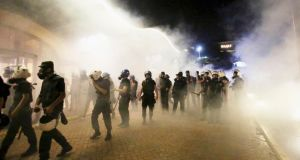 Riot police walk through clouds of teargas in central Istanbul overnight.   Photograph: Serkan Senturk/Reuters