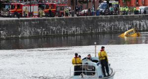 Emergency services on the scene as an amphibious tour bus sank in Liverpool's Albert Dock. Photograph:  Peter Byrne/PA Wire
