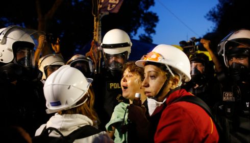 Protesters react as riot police order them to evacuate Gezi Park. Photograph: Murad Sezer/Reuters