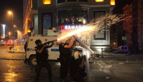 A riot policeman fires tear gas during an anti-government protest in Istanbul. Photograph: Reuters