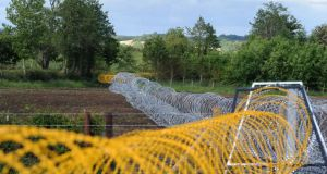 Entanglement wire encloses Lough Erne and the surrounding area ahead of the G8 summit tomorrow. Photograph:  Joe Giddens/PA Wire