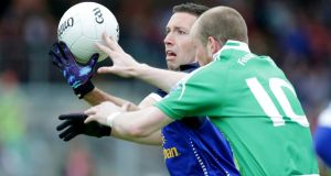 Fermanagh's Conor Quigley (right) battles for possession with Ronan Flanagan of Cavan at Brewster Park. Photograph: Morgan Treacy/Inpho
