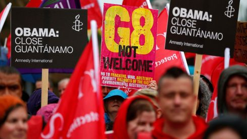 People take part in a demonstration in Belfast against the upcoming G8 summit. Leaders of the G8 countries will meet at Lough Erne in Co Fermanagh  on June 17th and 18th.    Photograph: Yves Herman/Reuters
