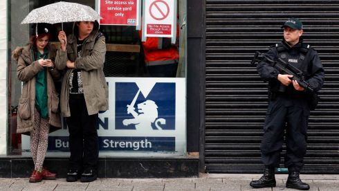 An armed police officer patrols the Belfast city centre during an anti-G8 demonstration. Photograph: Cathal McNaughton/Reuters