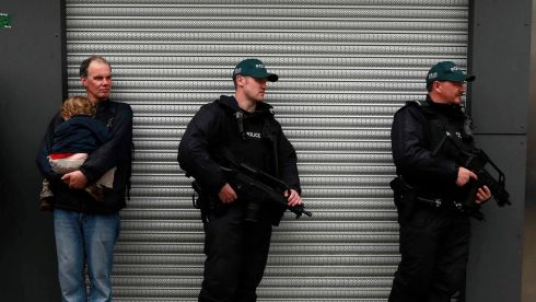 Armed police officers patrol Belfast city centre during an anti-G8 demonstration. Photograph: Cathal McNaughton/Reuters