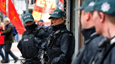 Police officers keep guard outside of a bank in Belfast during a protest against the upcoming G8 summit. Photograph: Yves Herman/Reuters