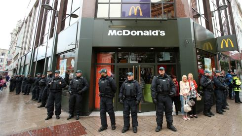A heavy police presence outsidse McDonalds  as anti G8 protests take place in Belfast. Photograph: Niall Carson/PA Wire