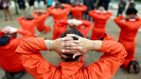 Activists from Amnesty International dressed as Guantanamo Bay detainees take part in a photo call in front of the Waterfront Hall in Belfast. Photograph: Cathal McNaughton/Reuters