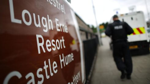 A policeman walks past a sign pointing to the Lough Erne Resort. Photograph: Peter Macdiarmid/Getty Images