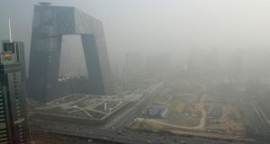The China Central Television building is seen next to a construction site in heavy haze in Beijing's central business district. China is considering plans to cut coal consumption in some major industrial regions, as part of measures to reduce air pollution –  an issue that has triggered a surge in public protests. Photograph:   Jason Lee/Reuters