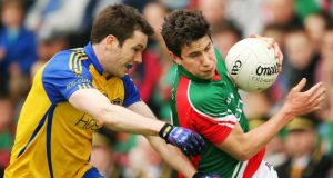 Mayo's Alan Freeman (right) and Niall Carty of Roscommon at MacHale Park. Photograph: Cathal Noonan/Inpho
