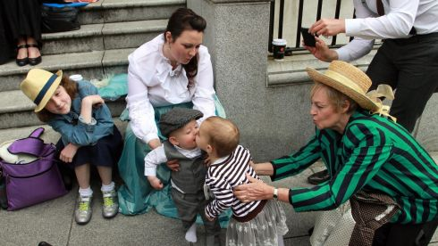 Lucas Joyce Kemper (8 months) and Evie Marie Joyce (18 months) enjoy a Bloomsday kiss, with Christina Cotter Reilly (9), Sabrina Joyce Kemper and Joyce Joyce outside the James Joyce Centre. Photograph: Nick Bradshaw/The Irish Times