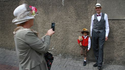 Thelma Keenan photographing 7-year-old Jonathan Aguiard and Hal Ledford in Dun Laoghaire today. Photograph: Nick Bradshaw/The Irish Times