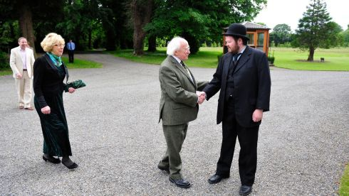 President Michael D Higgins meeting Aaron Hughes dressed as Leopold Bloom at Bloomsday celebrations in Aras an Uactarain today.