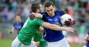 Fermanagh's Brian Cox does best to tackle  Eugene Keating of Cavan during the Ulster football championship quarter-final at  Brewster Park. (Photograph: Morgan Treacy/Inpho)