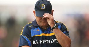 A dejected Roscommon manager John Evans during the final minutes of the Connacht semi-final defeat to Mayo at MacHale Park. (Photograph: Cathal Noonan/Inpho)