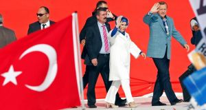 Turkish prime minister Tayyip Erdogan and his wife Emine wave to supporters as they arrive at a rally of ruling AK party in Istanbul yesterday.  Photograph: Reuters/Murad Sezer
