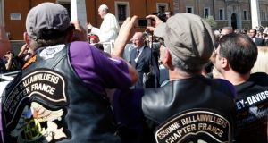 Pope Francis blesses the Harley-Davidson bikers from his Popemobile before the start of a mass outside Saint Peter's Square in Rome yesterday. Photograph: Reuters/Stefano Rellandini