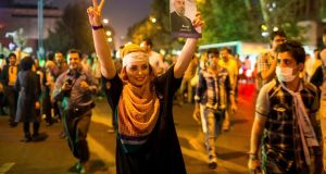 A supporter of moderate cleric Hassan Rohani celebrates his victory in Iran's presidential election in Tehran. Photograph: Reuters/Fars News/Sina Shiri