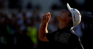 ustin Rose of England looks to the heavens in acknowledgement of his deceased father after putting on the 18th hole to complete the final round of the 113th US Open at Merion Golf Club in Ardmore, Pennsylvania. Photograph:  Ross Kinnaird/Getty Images