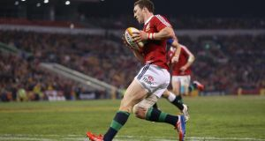 George North breaks clear for his first try during the match between Combined Country and the British & Irish Lions at Hunter Stadium. Photograph:  David Rogers/Getty Images