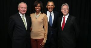 Handout photo  of First Minister Peter Robinson (right) and deputy First Minister Martin McGuinness (left) meeting US President Barack Obama and his wife Michelle at the Waterfront Hall in Belfast at the beginning of the G8 Summit. Photograph: PA.