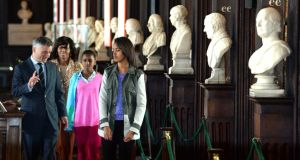 US First Lady Michelle Obama and  her daughters, Sasha and Malia with Dr Patrick Prendergast, President and Provost of Trinity College Dublin, during their visit to view the Book of Kells and archives documenting the Obama's Irish ancestry. Photograph: Cyril Byrne / THE IRISH TIMES