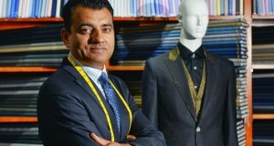Apsley director Arshad Mahmood with the suit featuring 22-carat gold stitching, a gold waistcoat and diamond-encrusted gold buttons