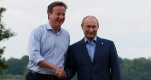Britain's prime minister David Cameron welcomes Russia's President Vladimir Putin to the Lough Erne golf resort. Photograph: Suzanne Plunkett /Reuters