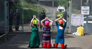 Demonstrators wear Free Pussy Riot balaclavas as they protest at the security fence surrounding the G8 Summit at Lough Erne in Enniskillen. Photograph: Cathal McNaughton/Reuters