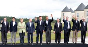 Britain's prime minister David Cameron (5th from left) has a group photograph taken with (l-r) European Commission president Jose Manuel Barroso; Japan's prime minister Shinzo Abe; German chancellor Angela Merkel; Russia's president Vladimir Putin; Cameron; US president Barack Obama; France's president Francois Hollande; Canada's prime minister Stephen Harper; Italy's prime minister Enrico Letta and European Council president Herman Van Rompuy, at the G8 Summit, at Lough Erne, Co Fermanagh, today. Photograpgh: Suzanne Plunkett/Reuters