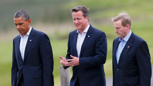 Taoiseach Enda Kenny, present at the G8 summit due to Ireland's presidency of the EU, at Lough Erne with US president Barack Obama and British prime minister David Cameron. Photograph: Photograph: Andrew Winning/Reuters