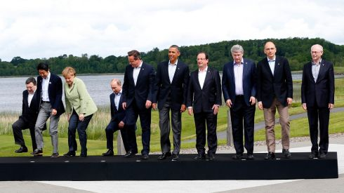 Get in line and say cheese! G8 and EU leaders line up for a photograph at Lough Erne. Left to right are European Commission president José Manuel Barroso, Japan's prime minister Shinzo Abe, German chancellor Angela Merkel, Russia's president Vladimir Putin, British prime minister David Cameron, US president Barack Obama, France's president Francois Hollande, Canada's prime minister Stephen Harper, Italy's prime minister Enrico Letta and European Council president Herman Van Rompuy. Photograph: Yves Herman/Reuters