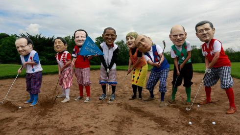 Oxfam activists depict G8 leaders in a bid to highlight world hunger during the Lough Erne summit, at Enniskillen Golf Course in Enniskillen. Photograph: Cathal McNaughton/Reuters